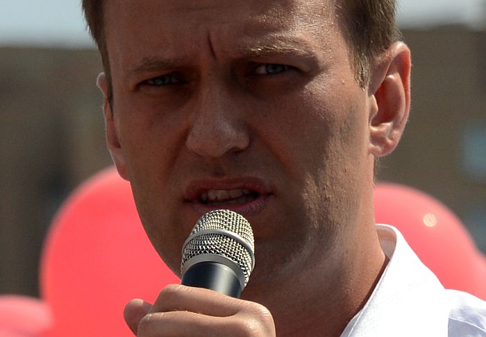 Russian opposition leader Alexey Navalny, who is standing for Moscow mayor while facing prison for fraud delivers a speech during a campaign meeting in Moscow on August 8, 2013. AFP PHOTO / VASILY MAXIMOV