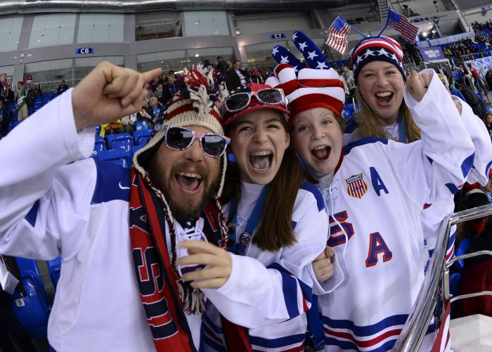 TOPSHOTS USA Ice Hockey supporters cheer their team prior to the Women's Ice Hockey Group A match Canada vs USA at the Shayba Arena during the Sochi Winter Olympics on February 12, 2014. AFP PHOTO / JONATHAN NACKSTRAND
