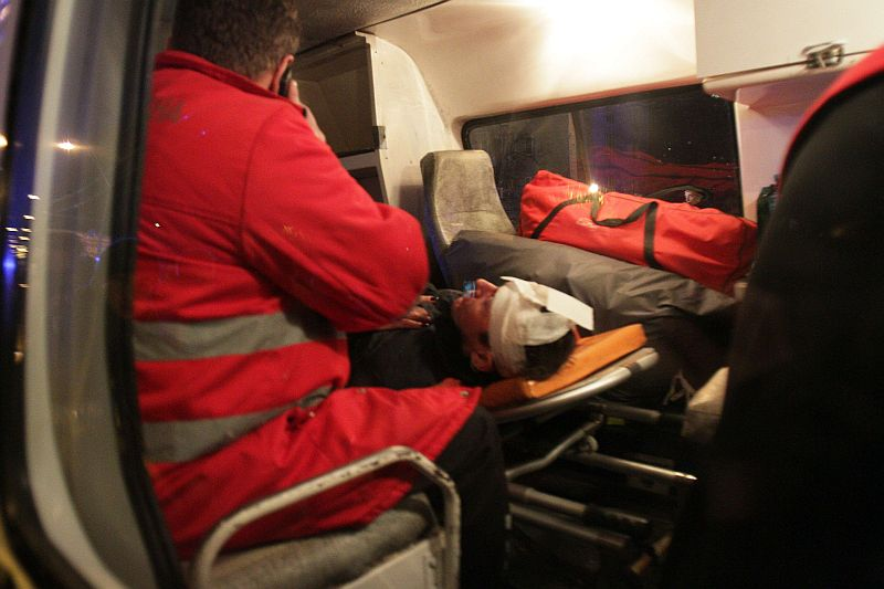 A wounded Ukrainian pro-European opposition activist is in a ambulance after clashing with the riot police near a district court in Kiev on January 11, 2014.  The activists were protesting against a court decision regarding several activists accused of terrorism. AFP PHOTO / ANATOLII BOIKO