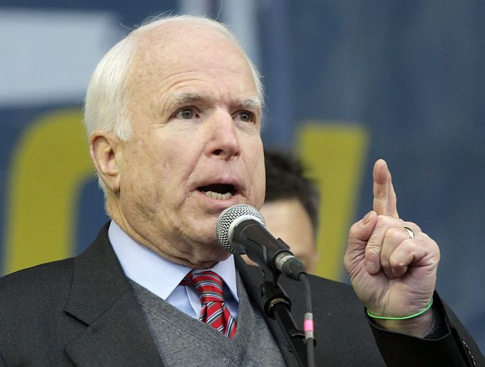 epa03991933 US Senator John McCain speaks during a pro-European rally on the Independence Square in Kiev, Ukraine, 15 December 2013. As Ukrainian President Viktor Yanukovych and leaders of Ukrainian opposition participated in a round table event to discuss public proposals aimed at achieving political stability, public peace and tranquility in Ukraine, the mass demonstrations in Kiev continued, with up to 20,000 anti-government protesters reinforcing barricades, emboldened by police assurances that they would not be cleared by force. Ukraine hopes to continue work on an association deal with the European Union, a spokesman for Prime Minister Nikolai Azarov said 15 December. Ukraine would only react to official EU comments on the state of negotiations, he told Russia's Interfax news agency, indicating Ukraine was not acknowledging a Sunday tweet from the EU's neighbourhood policy commissioner saying the talks were 'on hold.'  EPA/TATYANA ZENKOVICH  EPA/TATYANA ZENKOVICH