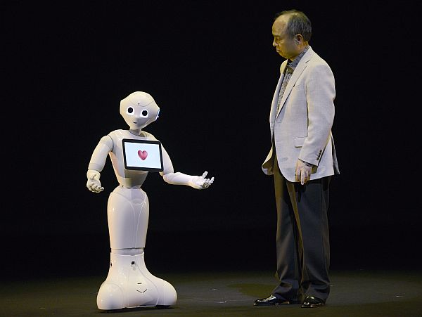 SoftBank CEO and chairman Masayoshi Son interacts with humanoid robot 'Pepper' during its unveiling at a press event held near Tokyo in Urayasu, Chiba prefecture, Japan, 05 June 2014. Capable of interacting through emotions and body langage, Pepper is the described by the developers as the 'World's first personal robot that reads emotions.' It will be on sale from February 2015 for a base price of 198,000 JPY (1,930 USD). The robot was developed in collaboration with French company Aldebaran Robotics.
