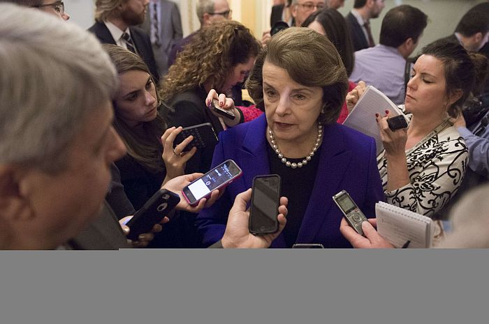 Senate Intelligence Chairwoman Dianne Feinstein (C), a Democrat from California, speaks to reporters about the committee's report on CIA interrogations at the US Capitol in Washington, DC, December 9, 2014.  The CIA's interrogation of Al-Qaeda suspects was far more brutal than acknowledged and did not produce useful intelligence, a damning and long-delayed US Senate report said Tuesday. The Central Intelligence Agency also misled the White House and Congress with inaccurate claims about the program's usefulness in thwarting attacks, the Senate Intelligence Committee said. AFP PHOTO / SAUL LOEB