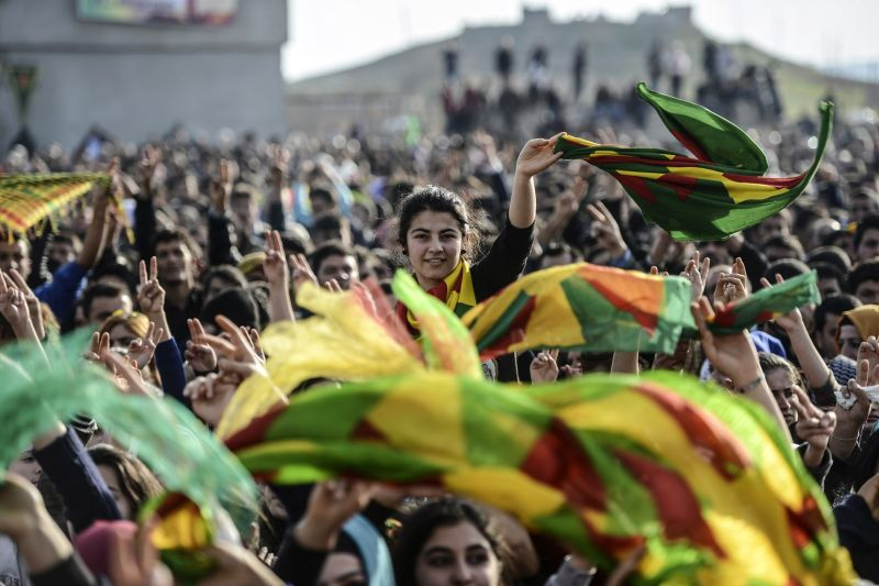 Kurdish people attend a celebration rally near the Turkish-Syrian border at Suruc, in Sanliurfa province on January 27, 2015. Kurdish fighters have expelled Islamic State group militants from the Syrian border town of Kobane, a monitor and spokesman said today, dealing a key symbolic blow to the jihadists' ambitions.