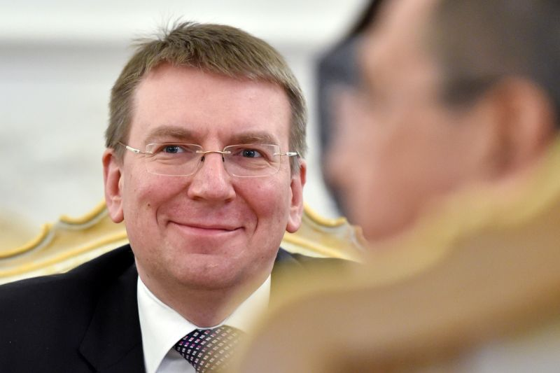 Latvian Foreign Minister Edgar Rinkevics smiles during a meeting with his Russian counterpart in Moscow on January 12, 2015.