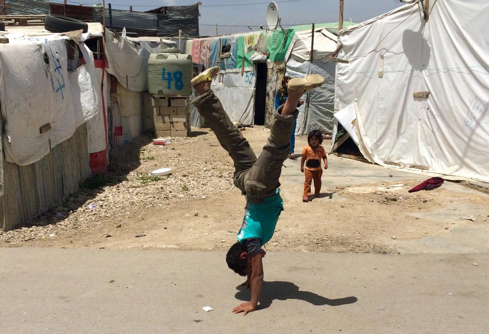 Bērns bēgļu nometnē Libānā.