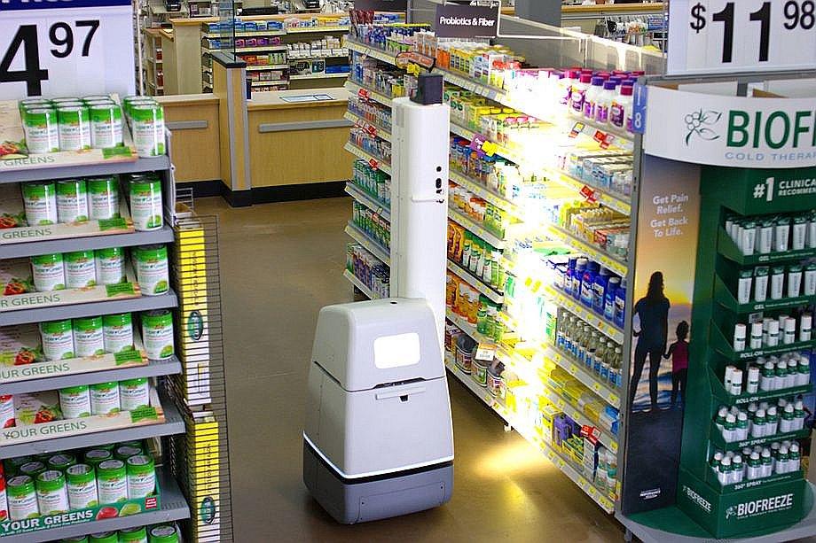 """""""Walmart"""" plauktu skenēšanas robots ir apmēram 60 centimetrus augsts ar īpašu izbīdāmu torni, uz kura izvietotas gaismas un sensori."""