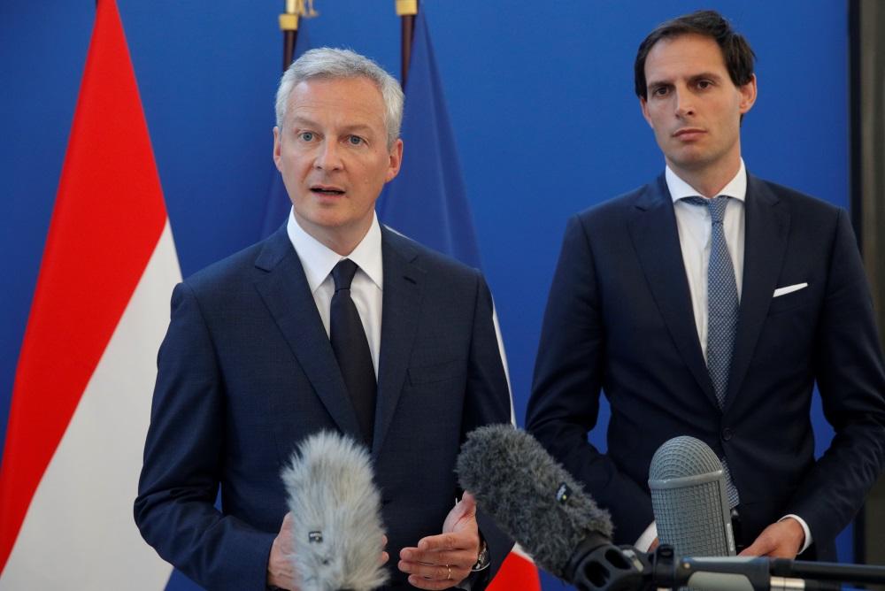 Francijas finanšu ministrs Bruno Lemērs (foto no kreisās), 11.05.2018.
