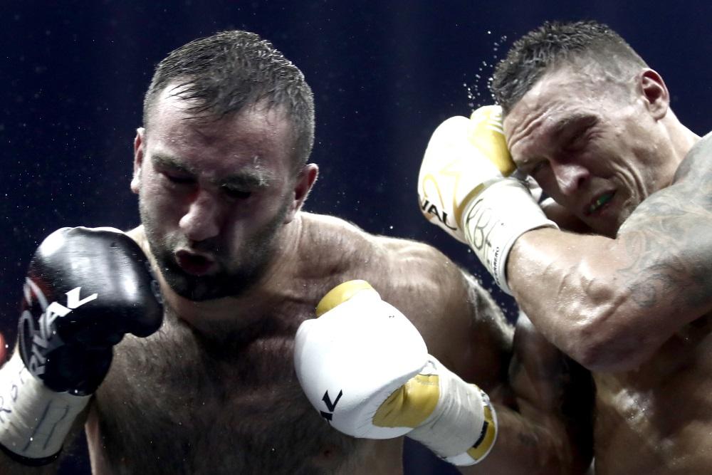 Ukrainas bokseris Oleksandrs Usiks sestdien Maskavā pēc punktiem uzvarēja Muratu Gasijevu, 21.07.2018.