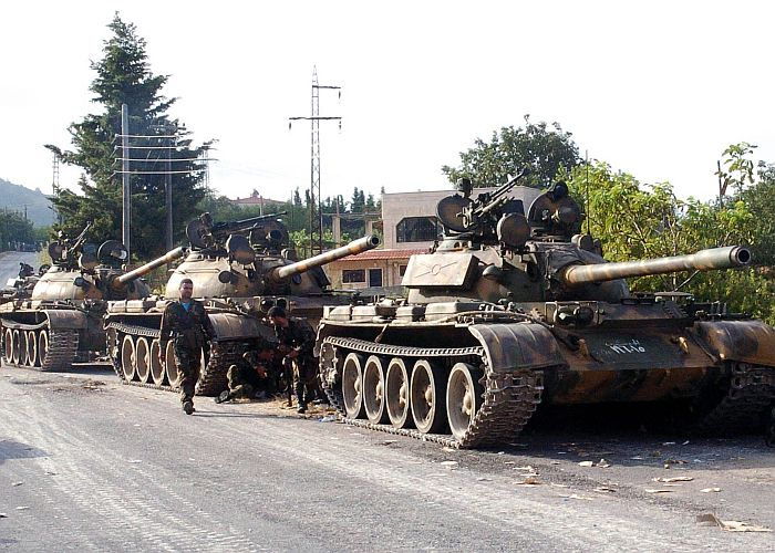 "A handout picture released by the Syrian Arab News Agency (SANA) on August 8, 2013 shows Syrian army tanks parked on the side of a road during an alleged pursuit of opposition fighters in the Latakia province, western Syria. Syria took the rare step of denying reports of an attack on President Bashar al-Assad's motorcade as he drove to a Damascus mosque for prayers marking Muslim holidays. AFP PHOTO/HO/SANA == RESTRICTED TO EDITORIAL USE – MANDATORY CREDIT ""AFP PHOTO / HO / SANA"" – NO MARKETING NO ADVERTISING CAMPAIGNS – DISTRIBUTED AS A SERVICE TO CLIENTS====="