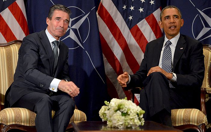 epa04141980 US President Barack Obama (R) and NATO Secretary General Anders Fogh Rasmussen (L) are pictured during a meeting at the NATO headquarters in Brussels, Belgium, 26 March 2014. Obama is visiting the American Flanders Field cemetery in Waregem and has several meetings with leaders of the European Institutions.  EPA/STEPHANIE LECOCQ