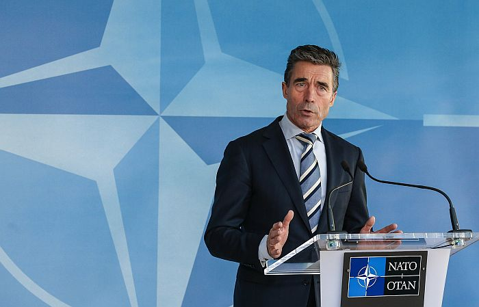 epa04105874 Danish NATO Secretary General Anders Fogh Rasmussen speaks at a media briefing at the Nato headquarters in Brussels, Belgium, 02 March 2014. Russia's military actions in Ukraine pose a threat to Europe, NATO chief Rasmussen said 02 March ahead of special talks by the alliance's ambassadors on the crisis. NATO leaders met 02 March after the interim Ukrainian government requested the alliance's support against Russia, whose parliament authorized the use of military force in the country. Reports state that Poland asked for an emergency meeting of the Council of the North Atlantic Treaty Organization NATO, feeling threatened by the potential armed intervention of Russia in neighboring Ukraine.  EPA/JULIEN WARNAND