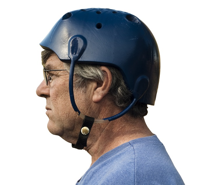 man wearing a seizure helmet for protection with clipping path included