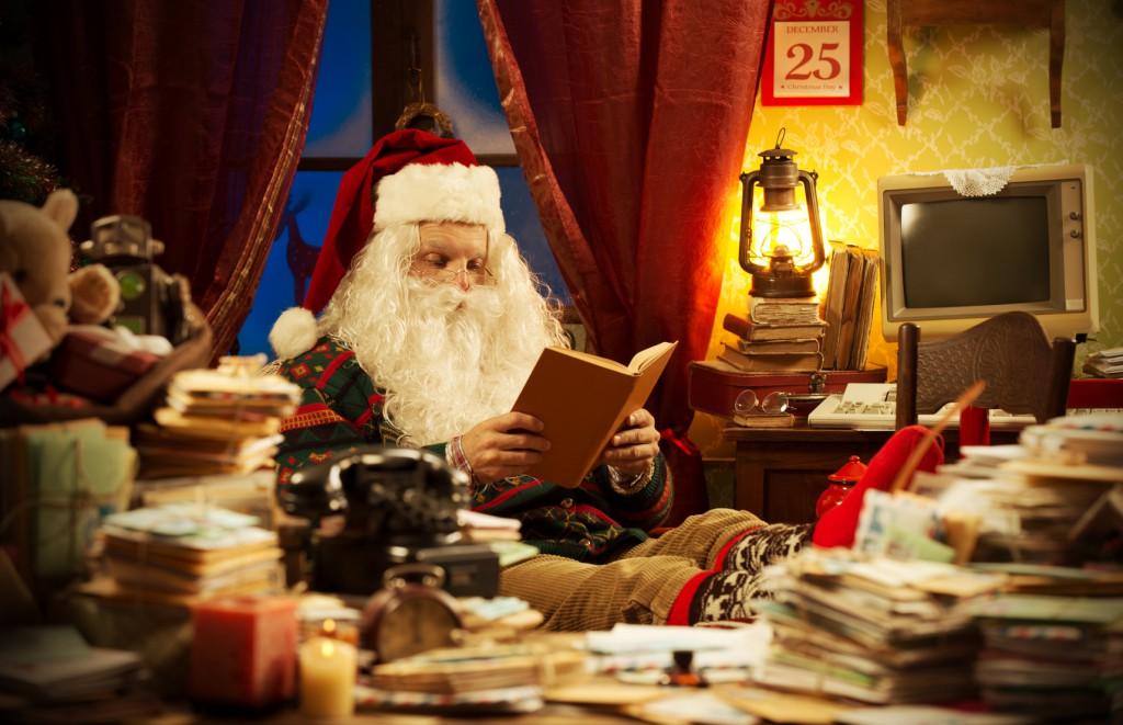 Santa Claus reading a book at home
