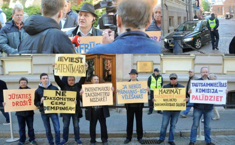 Taksometru pārvadātāju pikets. Pie Saeimas komisiju ēkas notiek taksometru pārvadātāju un taksometru vadītāju saskaņots pikets, lai pievērstu deputātu uzmanību nozares samilzušajām problēmām un aicinātu izveidot darba grupu. Jēkaba iela 11